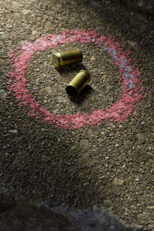 Two bullets with chalk around