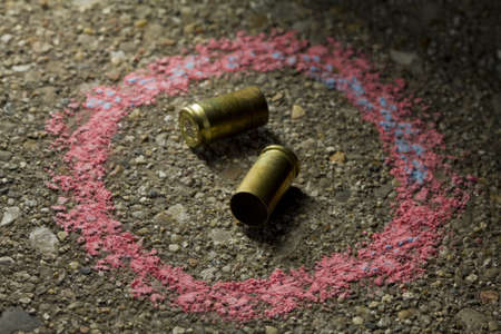 Two bullets with chalk around Stock Photo - 19125426