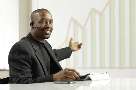 African American business man presenting profits, horizontal Stock Photo