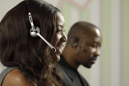 telephone interview: African American business woman taking a sales call using a headset, horizontal