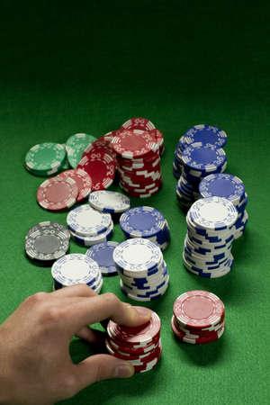 Gambler raises bet, vertical photo