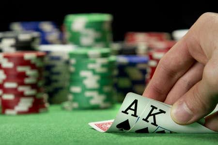card player: Card player checks his hand, horizontal Stock Photo
