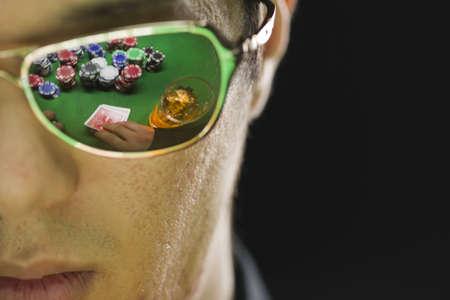 Poker player in sunglasses, horizontal