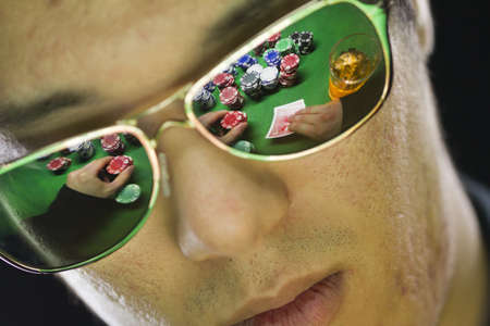 Poker player in sunglasses, horizontal
