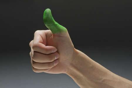 green thumb: Green thumb, horizontal Stock Photo
