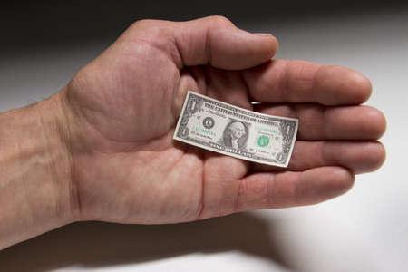 Tiny dollar bill in palm, horizontal Stock Photo - 21096233