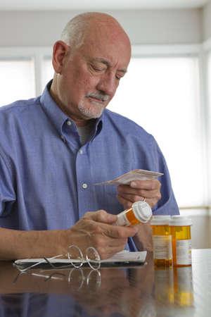 the label: Older man with prescription medications, vertical