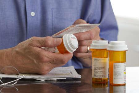 Older man with prescription medications, horizontal