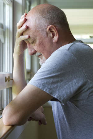 Older man expressing pain or depression, vertical Stock Photo - 21096463