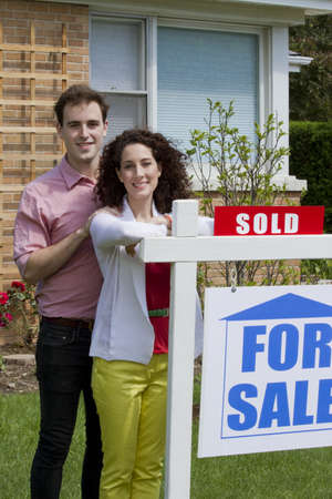 Couple selling house - sold, vertical Stock Photo - 21096519