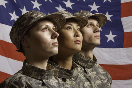one armed: Group of soldiers in front of American flag, horizontal Stock Photo