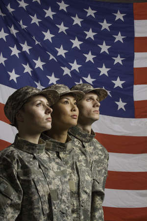 Group of soldiers in front of American flag, vertical