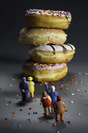 bad diet: Supersize epidemic - people looking at doughnuts Stock Photo