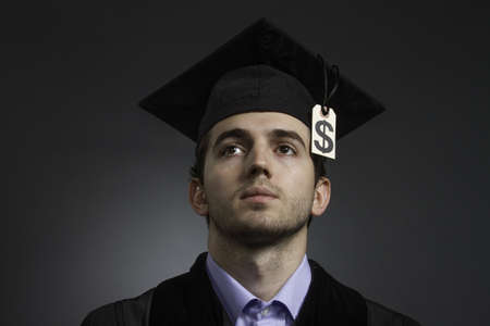 College graduate with tuition debt price tag, horizontal photo