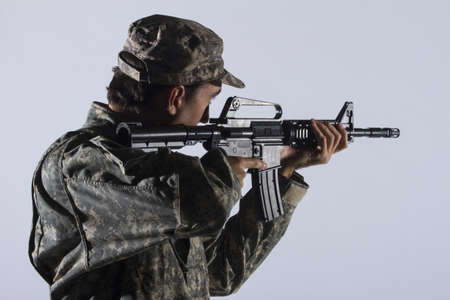 assault rifle: Soldier using assault rifle, horizontal