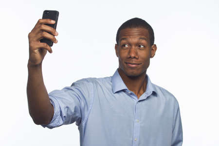 picture person: Young African-American man taking a picture of himself with smartphone, horizontal