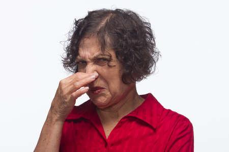 nose plugs: Woman plugs nose, horizontal Stock Photo