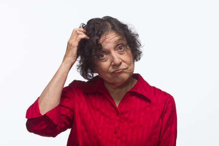 scratching head: Woman confused and scratching head, horizontal Stock Photo