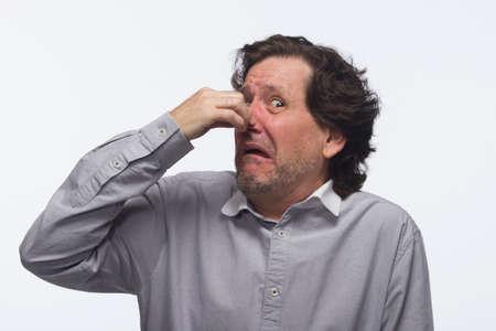 stinky: Man plugging nose, horizontal Stock Photo