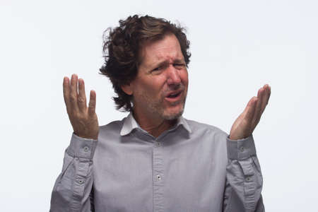 Frustrated man with hands in air, horizontal