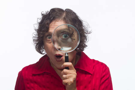 solver: Woman with magnifying glass, horizontal Stock Photo