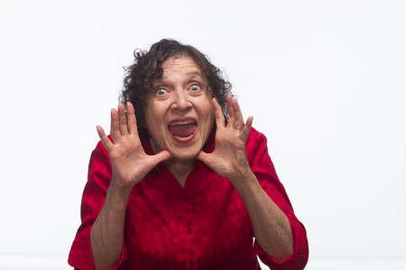 Woman yelling between hands,horizontal