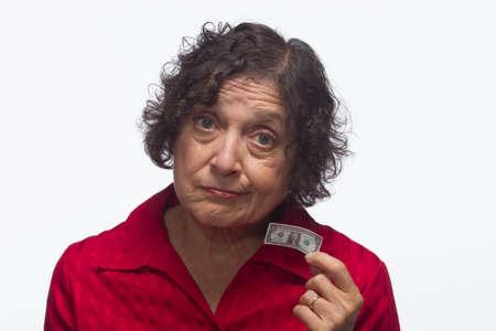 mujer decepcionada: Mujer decepcionada con el billete de un d�lar, horizontal Foto de archivo