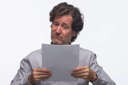 business skeptical: Hombre de negocios esc�ptico con los informes, horizontal Foto de archivo