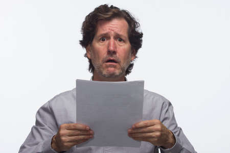 Upset man with report or paperwork, horizontal Stock Photo