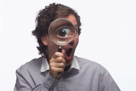 solver: Smiling man with magnifying glass, horizontal