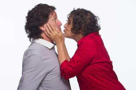 Woman surprising man with kiss, horizontal Stock Photo