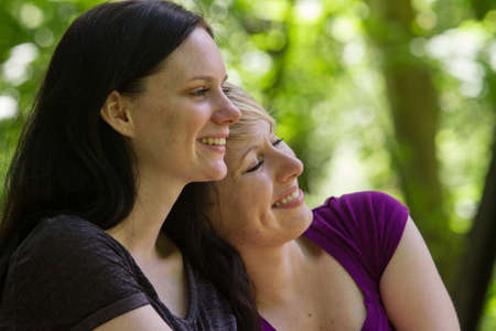 lesbian girls: Girlfriends sharing a romantic moment, horizontal Stock Photo