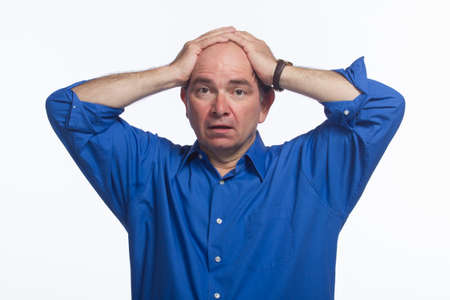 reacting: Man reacting and putting hands on head, horizontal Stock Photo