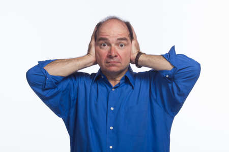 Older man covering ears, horizontal photo