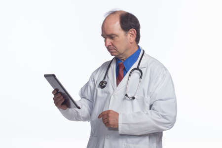 electronical: Doctor looking at results on electronical tablet, horizontal