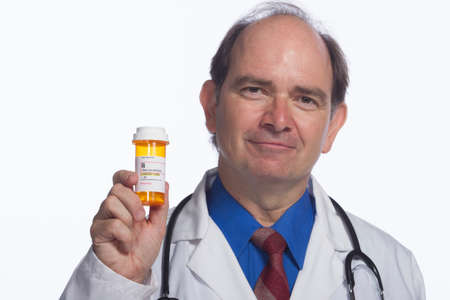 Close up of doctor smiling and holding prescription, horizontal photo