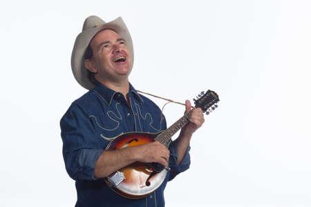 mandolino: L'uomo cantando e suonando il mandolino, orizzontale Archivio Fotografico