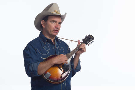 mandolin: Cowboy playing mandolin, horizonal