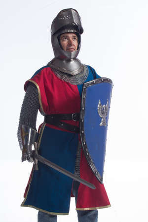 Knight in full armor, sword and shield, vertical photo