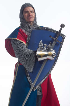 Knight in full armor with shield and sword, vertical photo