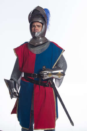 Man in full knight costume, vertical photo