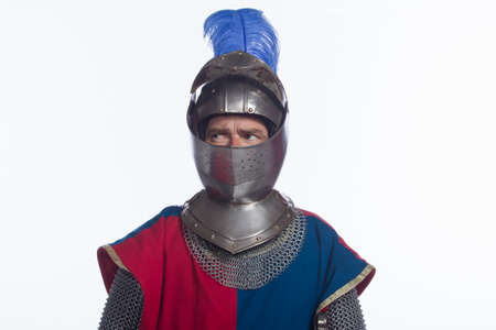 Man in knight costume looking sideways, horizontal photo