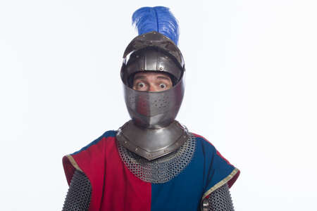 Man in knight costume looking surprised, horizontal photo