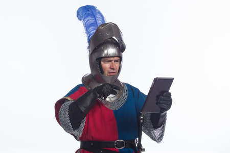 middleages: Confused knight using electronic tablet, horizontal