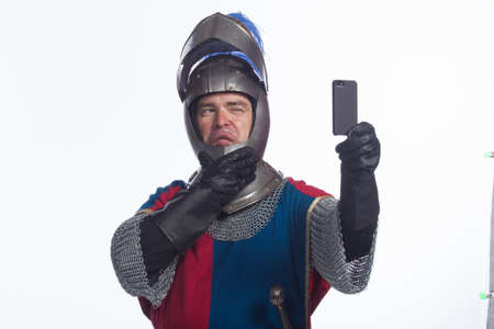 middleages: Man in knight costume taking a selfie, horizontal Stock Photo