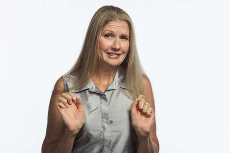 shy woman: Blonde woman looks guilty, horizontal