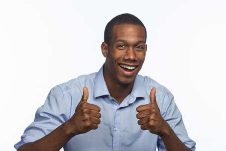 Young African American man gives two thumbs up, horizontal