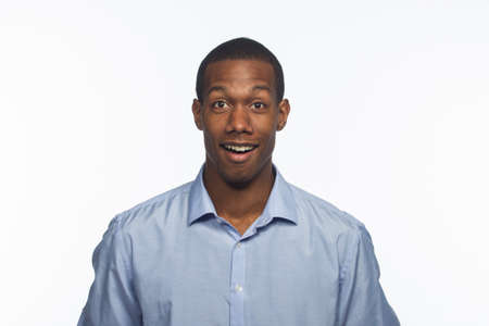 Handsome young black man smiling and surprised, horizontal