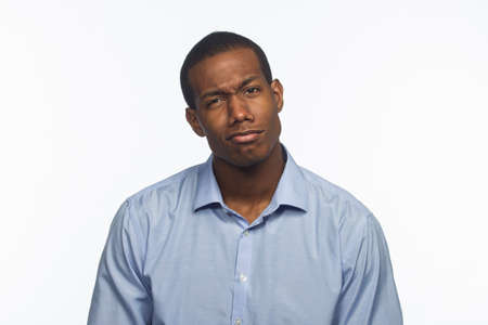 Young black man reacting with weird facial expression, horizontal photo