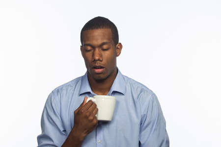 Tired black man with cup of coffee, horizontal Stock Photo